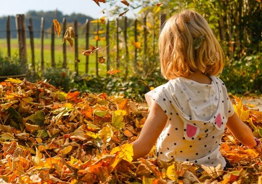 Girl-playing-with-leaves-3740723-cropped-780x372